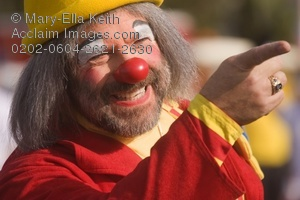 Name:  0202-0604-2621-2630_smiling_clown_with_a_yellow_hat_and_red_nose.jpeg Views: 268 Size:  27.0 KB